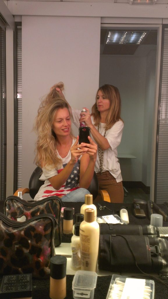 """Getting ready for our shooting. Paola working on my hair to create a wonderful lion style effect..."""
